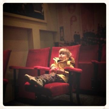 little-boy-sitting-in-old-fashioned-cinema
