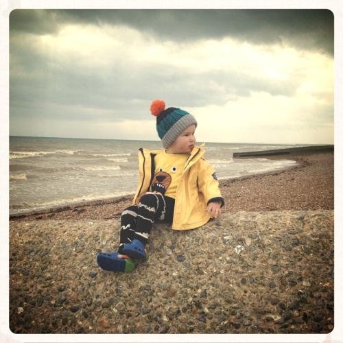 little-boy-sitting-on-the-beach