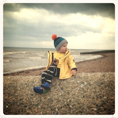 little-boy-sitting-on-the-beach