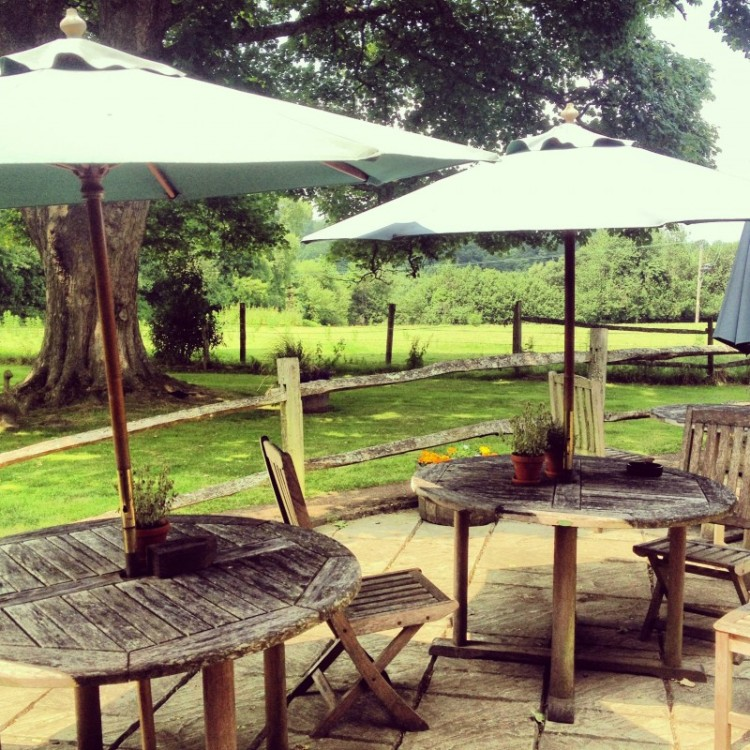 pub-tables-outside-with-parasols