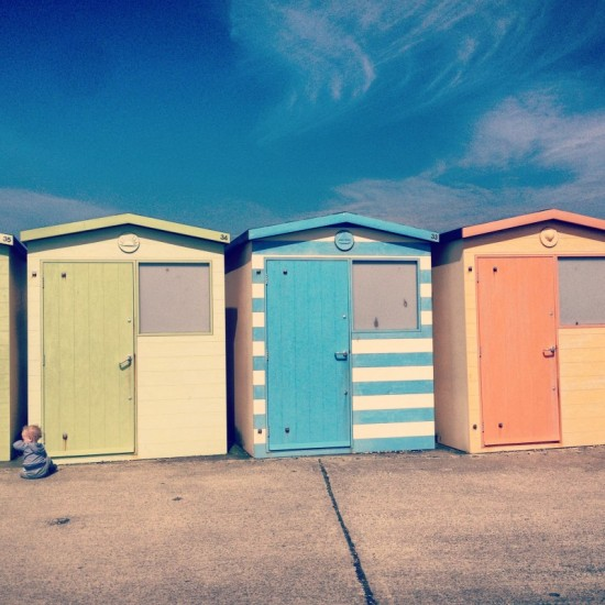 baby-sitting-in-front-of-beach-huts