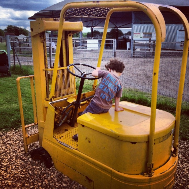 child-driving-yellow-forklift-truck