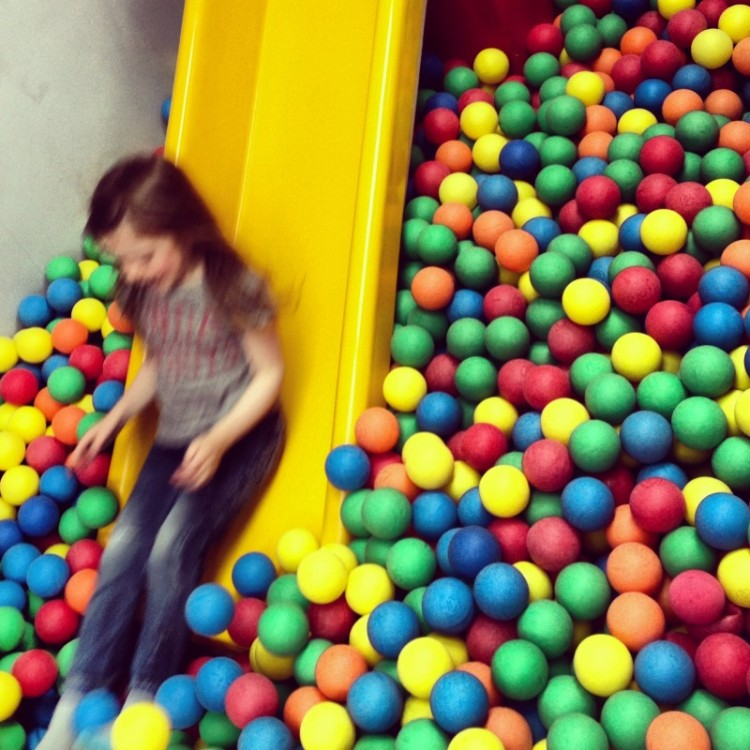 child-on-a-slide-into-ballpit