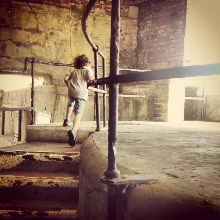 child-running-up-steps-of-gun-emplacement