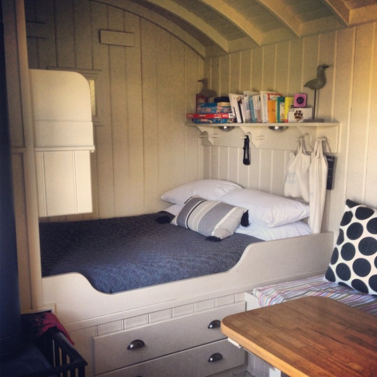 inside-of-shepherds-hut-showing-king-size-bed