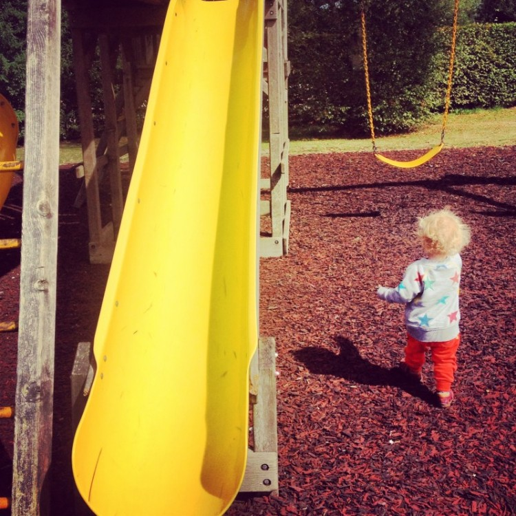 child-next-to-a-slide